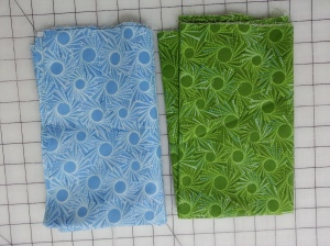 These 2 fabrics from my stash were eliminated. The colors just weren't quite right.